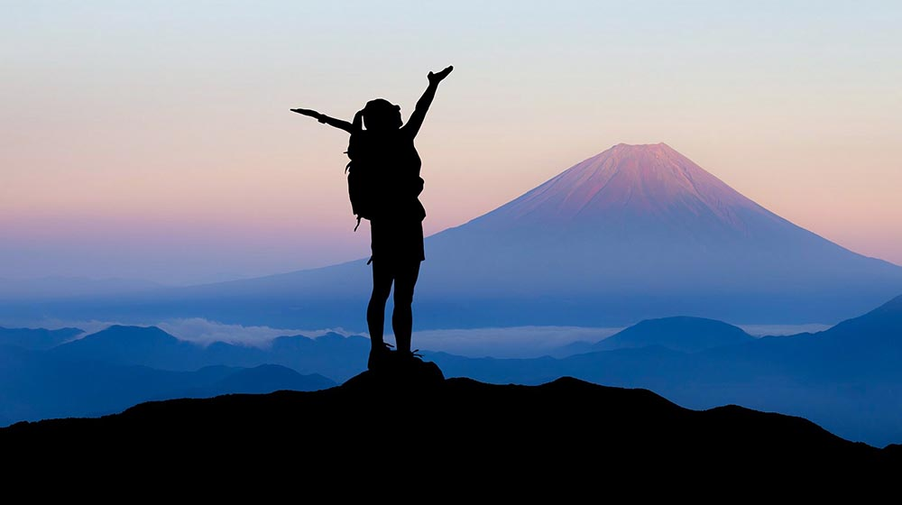 Picture of mountain climber for blog about how to improve your credit score
