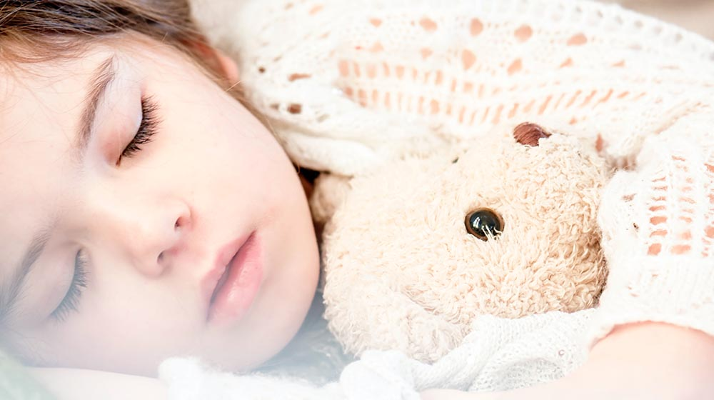 A child sleeping for a blog about the Gift of Warmth – Blanket, Clothing and Pajama Drive