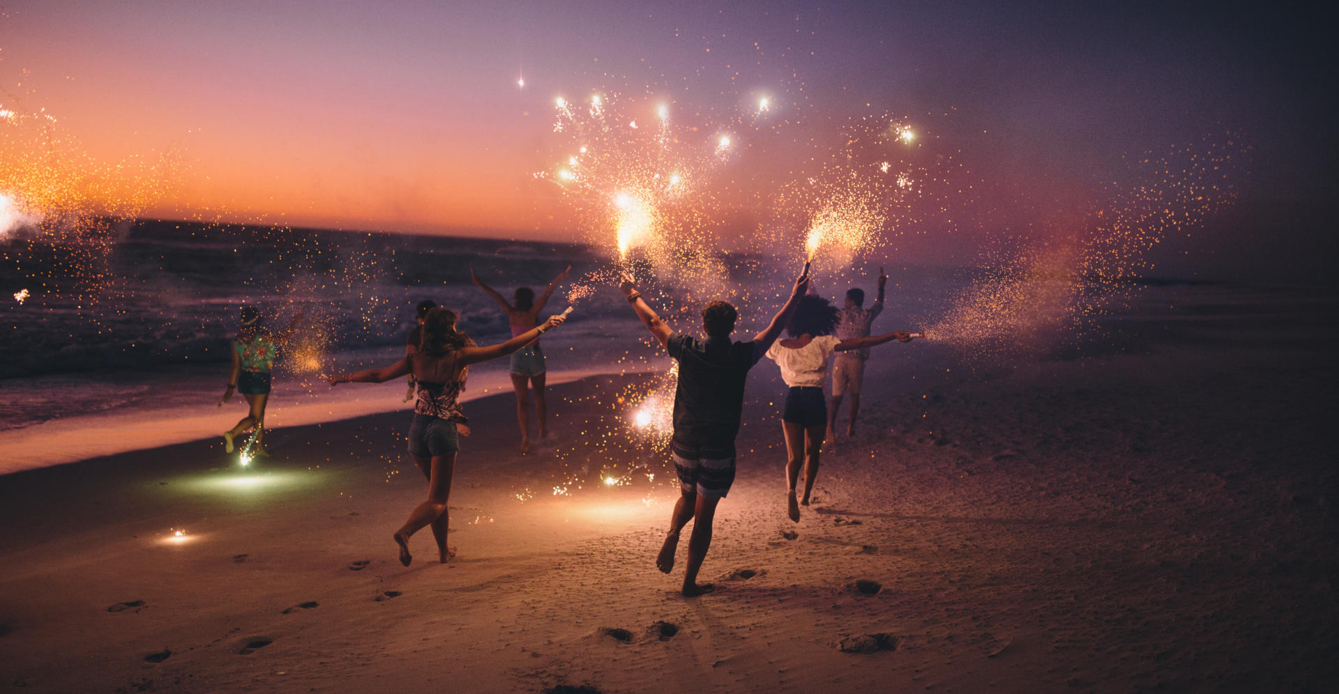 friend running with fireworks on a beach